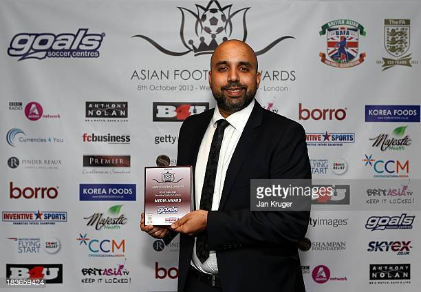 Media Award winner Amar Singh poses during the Second Annual Asian Football Awards at Wembley Stadium on October 8 2013 in London England
