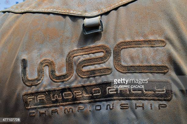 A media bib showing the WRC logo is pictured in the finish area of the 2015 FIA World Rally Championship in Sardegna on June 14 2015 France's...