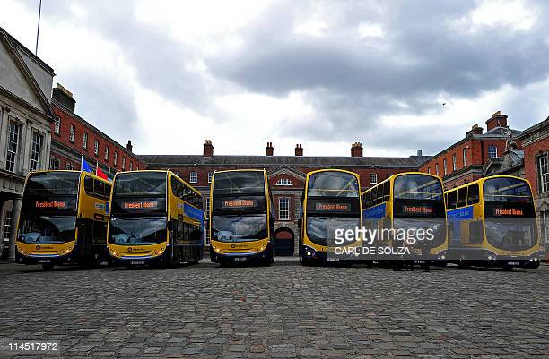 Media buses wait to transport media to a rally in Dublin on May 23 2011 US President Barack Obama will speak at a rally in Dublin's city centre to...