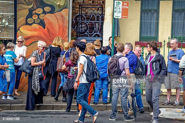 ISLAND SYDNEY NSW AUSTRALIA Media crowd around a narrow laneway to see the artwork by Colombianborn Londonbased artist Oscar Murillo during the media...