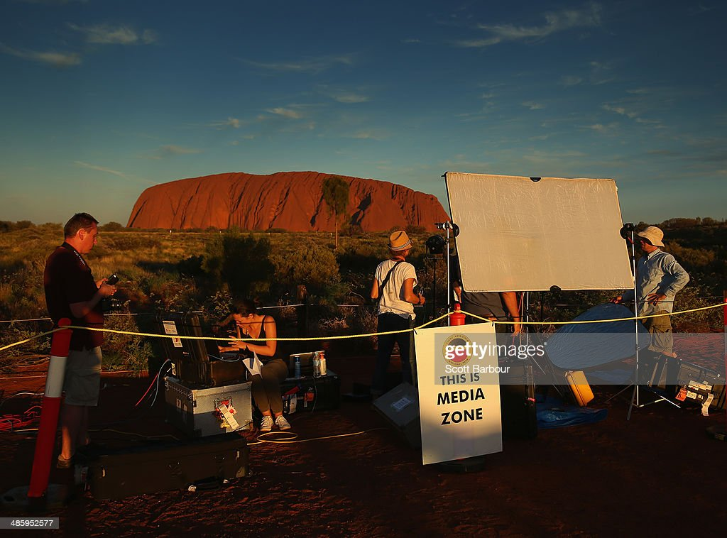 Media do preview pieces in front of Uluru, also known as Ayers Rock at sunset on April 21, 2014 in Ayers Rock, Australia. The Duke and Duchess of Cambridge are on a three-week tour of Australia and New Zealand, the first official trip overseas with their son, Prince George of Cambridge.