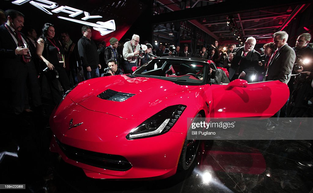 Media gather around the 7th-generation Chevrolet Corvette, the C7, after it was revealed to the media at the Russell Industrial Complex January 13, 2013 in Detroit, Michigan. The redesigned 2014 Corvette was unveiled at a preview of the 2013 North American International Auto Show, which opens in Detroit January 14th.