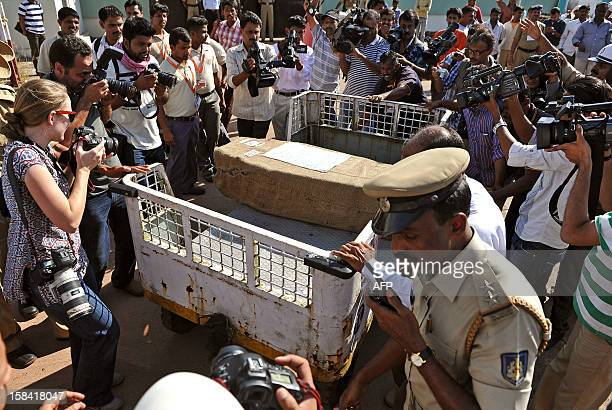 Media gather around the coffin carrying the body of Indiaborn nurse Jacintha Saldanha after she was brought out of the Bajpe Airport in Mangalore on...