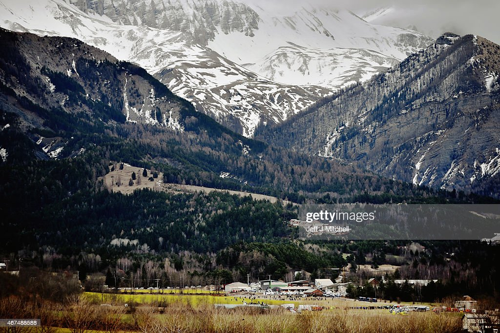 Media gather as teams and gendarmerie continue their search operation near the site of the Germanwings plane crash near the French Alps on March 25...