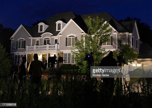 Media gather outside of New England Patriots player Aaron Hernandez's home in North Attleborough Mass June 19 2013 Hernandez has been linked to the...