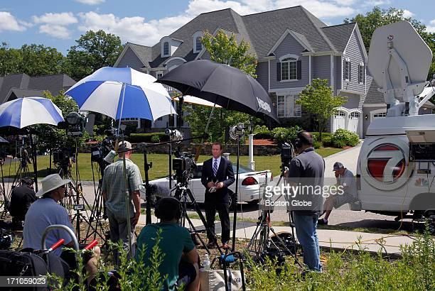 Media gather outside of New England Patriots player Aaron Hernandez's home in North Attleborough Mass June 20 2013 Hernandez has been linked to the...