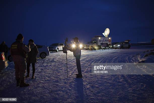 Media gather outside the entrance of the Malheur Wildlife Refuge Headquarters near Burns Oregon January 3 where an armed antigovernment group have...