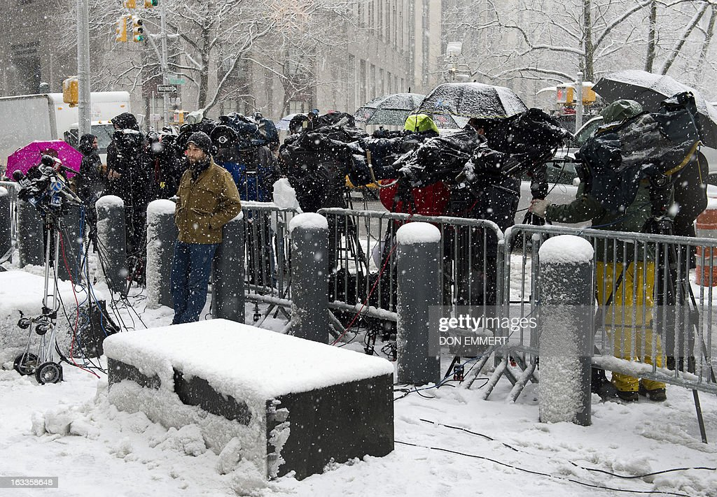 Media gather outside the Federal Courthouse in Manhattan March 8, 2013 in New York. Inside the court Osama bin Laden's son-in-law and former spokesman pleaded not guilty Friday to terrorism charges in New York, where he was brought a week ago after a top secret US operation. Sulaiman Abu Ghaith, reportedly a 47-year-old Kuwaiti and allegedly a senior propagandist in the Al-Qaeda network, is accused of conspiring 'to kill nationals of the United States.'