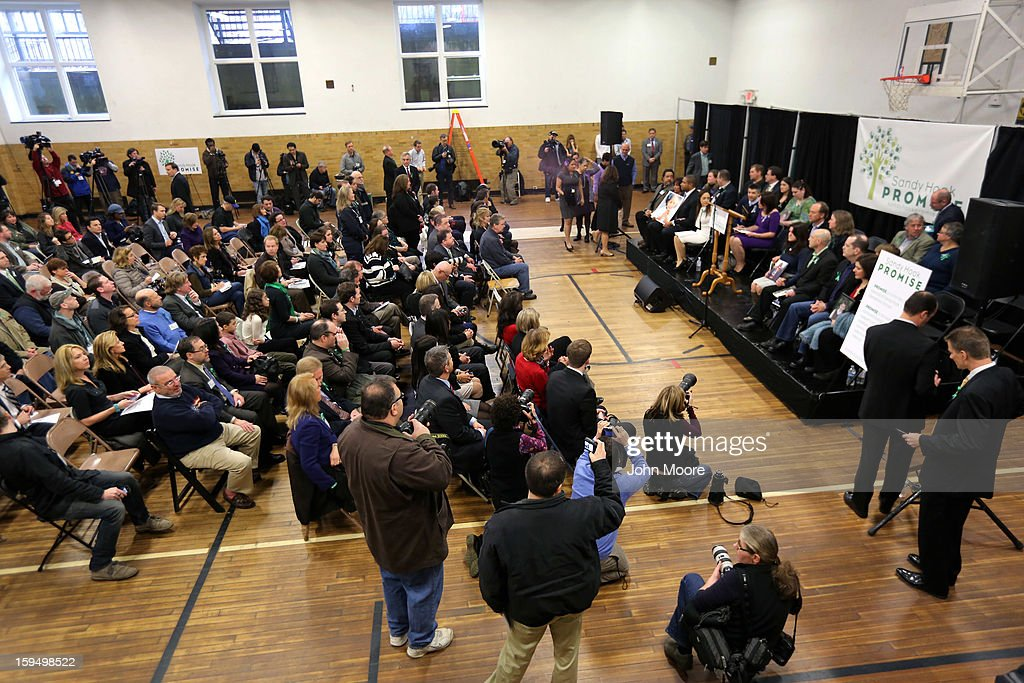 Media gathers to attend a press conference given by parents of Sandy Hook massacre victims (on right) on the one month anniversary of the Newtown elementary school massacre on January 14, 2013 in Newtown, Connecticut. Eleven families of Sandy Hook massacre victims came to the event one month after the shooting to give their support to Sandy Hook Promise, a new non-profit with the goal of preventing such tragedies in the future.