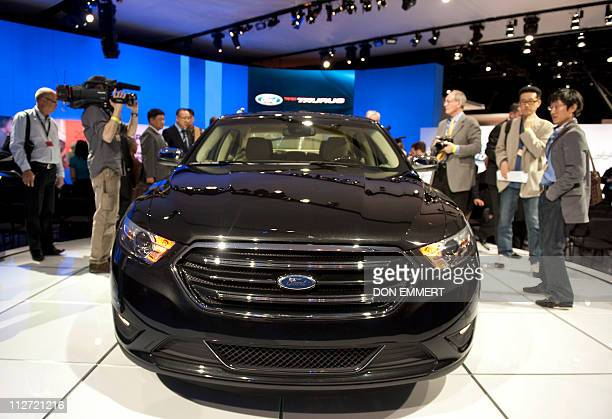 Media get a close look at a Ford Taurus April 20 2011 during the New York Auto show in New YorkAuto makers from around the world gathered to...