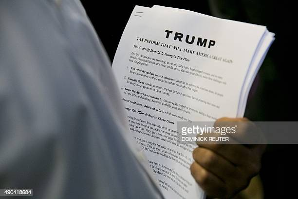 Media handouts describing the tax plan of Republican presidential hopeful Donald Trump's tax plan are viewed during a press conference at Trump Tower...