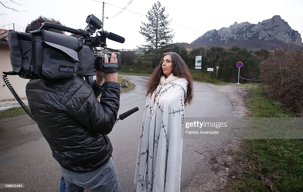 Media interview a woman in a cloak in Bugarach village after the Mayan Prophecy failed to occur on December 21, 2012 in Bugarach, France. The prophecy of an ancient Mayan calendar claimed that today would see the end of the world, and that Burgarach is the only place on Earth which will be saved from the apocalypse.