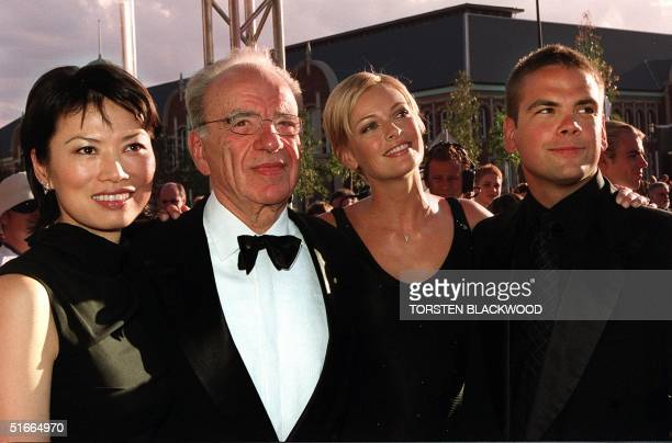 Media magnate Rupert Murdoch and his wife Wendy Deng son Lachlan and daughterinlaw Sarah O'Hare arrive for the official opening of Fox Studios...