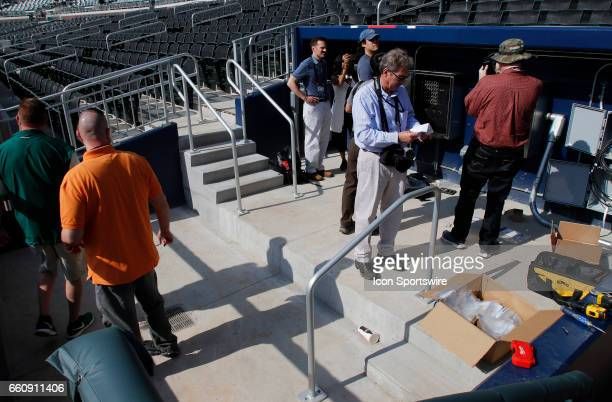 Media members examine the 1st base side photo well at the new SunTrust Park that is the new home of The Atlanta Braves on March 29 at SunTrust Park...
