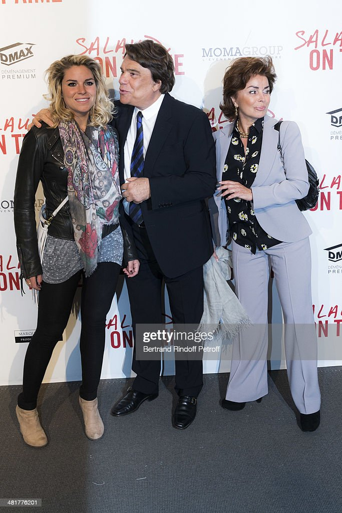 Media mogul <a gi-track='captionPersonalityLinkClicked' href=/galleries/search?phrase=Bernard+Tapie&family=editorial&specificpeople=586829 ng-click='$event.stopPropagation()'>Bernard Tapie</a> (C), his wife Dominique Tapie (R) and their daughter Sophie Tapie attend the premiere of French director Claude Lelouch's film 'Salaud, on t'aime' (Bastard, we love you) at Cinema UGC Normandie on March 31, 2014 in Paris, France.