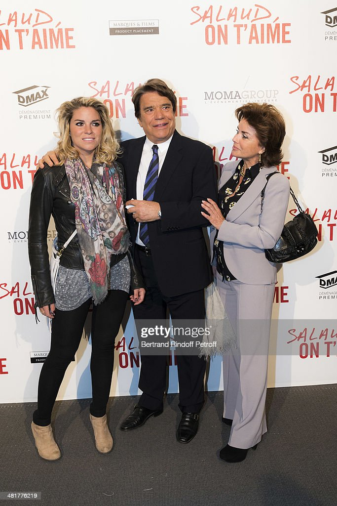 Media mogul Bernard Tapie (C), his wife Dominique Tapie (R) and their daughter Sophie Tapie attend the premiere of French director Claude Lelouch's film 'Salaud, on t'aime' (Bastard, we love you) at Cinema UGC Normandie on March 31, 2014 in Paris, France.