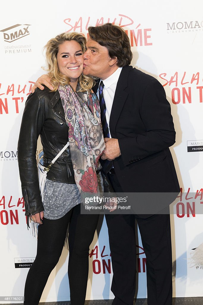 Media mogul <a gi-track='captionPersonalityLinkClicked' href=/galleries/search?phrase=Bernard+Tapie&family=editorial&specificpeople=586829 ng-click='$event.stopPropagation()'>Bernard Tapie</a> (R) kisses his daughter Sophie Tapie as they attend the premiere of French director Claude Lelouch's film 'Salaud, on t'aime' (Bastard, we love you) at Cinema UGC Normandie on March 31, 2014 in Paris, France.