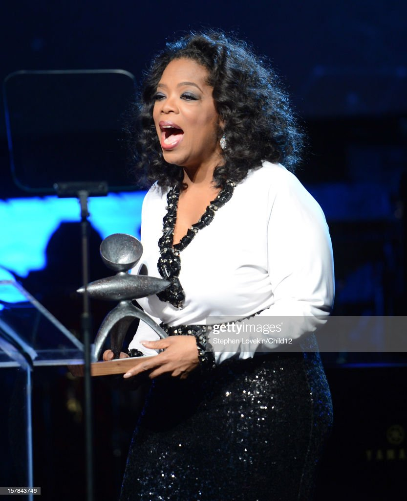 Media mogul Oprah Winfrey accepts an award on stage during Black Ball Redux at The Apollo Theater on December 6, 2012 in New York City.