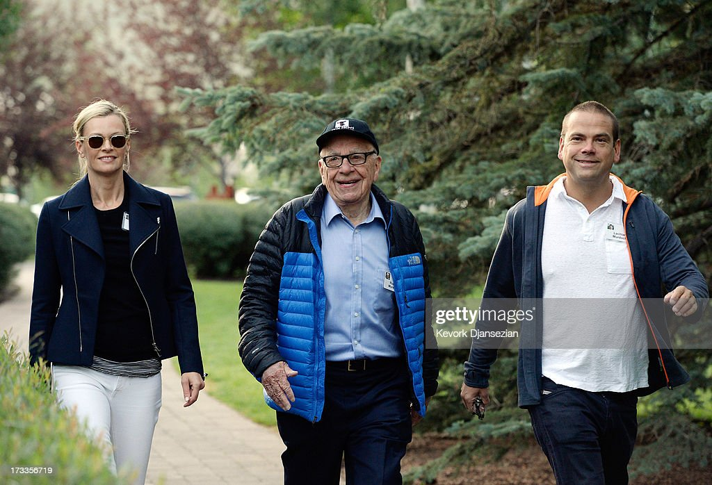 Media mogul Rupert Murdoch, (C) executive chairman of News Corporation and chairman and CEO of 21st Century Fox, arrives with his son Lachlan Murdoch, executive of Illyria Property Limited, and his wife Sarah Murdoch to the Allen & Co. annual conference on July 12, 2013 in Sun Valley, Idaho. The resort will host corporate leaders for the 31st annual Allen & Co. media and technology conference where some of the wealthiest and most powerful executives in media, finance, politics and tech gather for week long meetings. Past attendees included Warren Buffett, Bill Gates and Mark Zuckerberg.