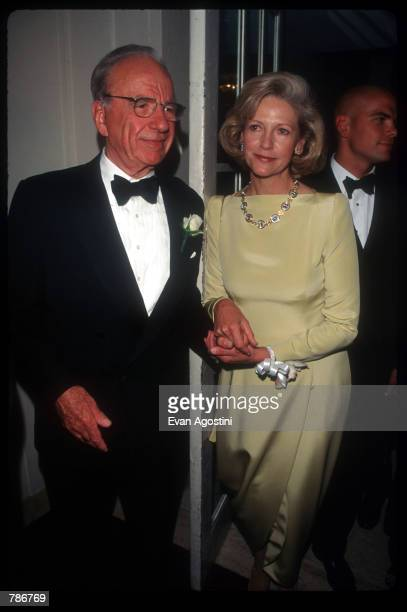 Media mogul Rupert Murdoch holds hands with his wife Anna at the Humanitarian of the Year Awards May 29 1997 in New York City Murdoch received the...