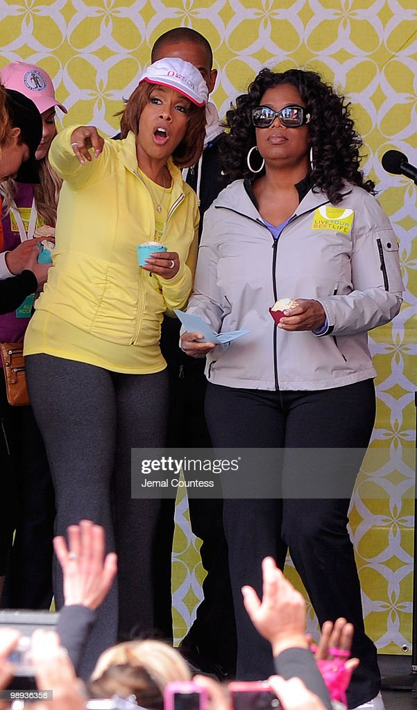 Media personalities Gayle King and Oprah Winfrey onstage at the completion of the 'Live Your Best Life Walk' to celebrate O The Oprah Magazine's 10th...