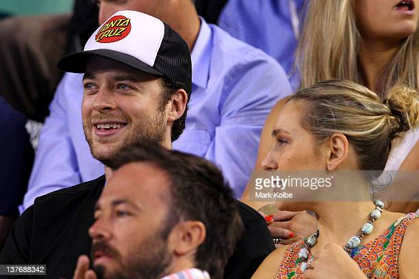 Media personality Hamish Blake and fiancee Zoe Foster watch the quarter final match between David Ferrer of Spain and Novak Djokovic of Serbia during...