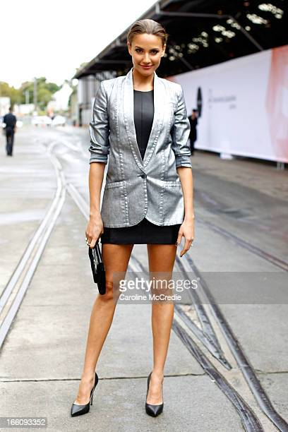 Media personality Rachael Finch wears an outfit by Ginger and Smart and carries a bag by Nude at MercedesBenz Fashion Week Australia Spring/Summer...