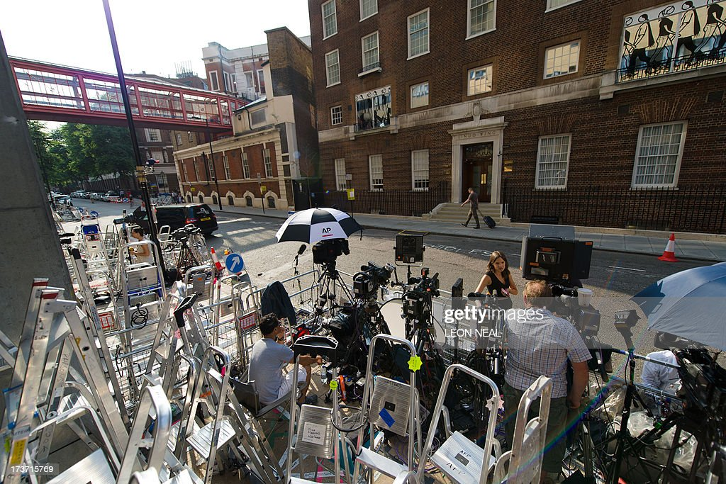 Media personnel and ladders are pictured outside the Lindo Wing of St Mary's Hospital in London, on July 17, 2013, where Prince William and his wife Catherine's baby is expected to be born. Britain's Prince Charles joked Monday that his son Prince William's baby was 'hopefully' on the way, but wife Camilla went further, saying it could arrive 'by the end of the week'.