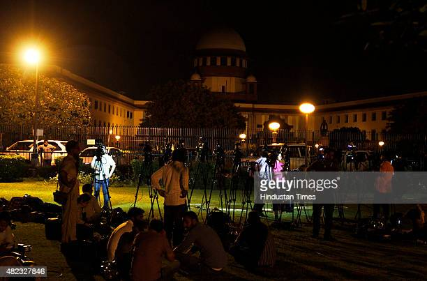 Media personnel wait for the decision regarding the execution of Yakub Memon outside the Supreme Court in early morning on July 30 2015 in New Delhi...