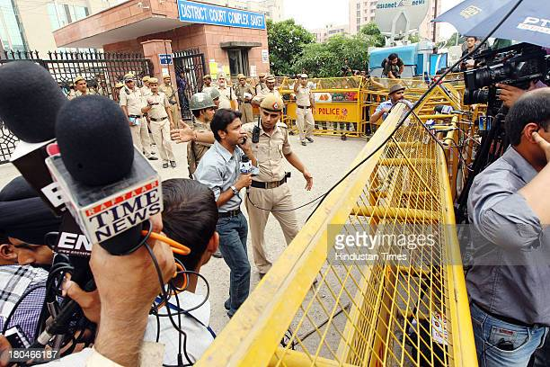 Media persons outside the Saket district court complex after a judge pronounced death sentence for all four men convicted in the rape and murder of a...