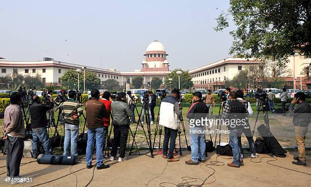 Media persons standing outside Supreme Court premises to cover the hearing against Sahara chief Subrata Roy on February 26 2014 in New Delhi India...
