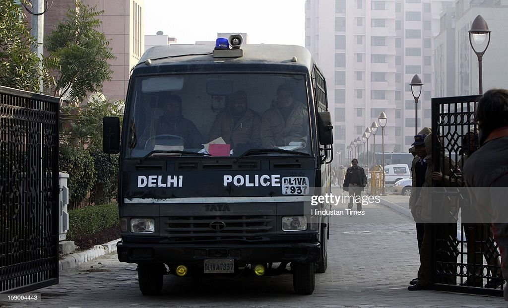 Media Persons taking pictures of the police van believed to carrying the five men accused in a gang rape case after the hearing at the Saket district court on January 7, 2013 in New Delhi, India. The men are accused of a gang rape of a 23 year old girl who later died due to injuries. The incident has caused outrage across India, sparking protests and demands for tough new rape laws and led to setting of special fast track courts for such incident.
