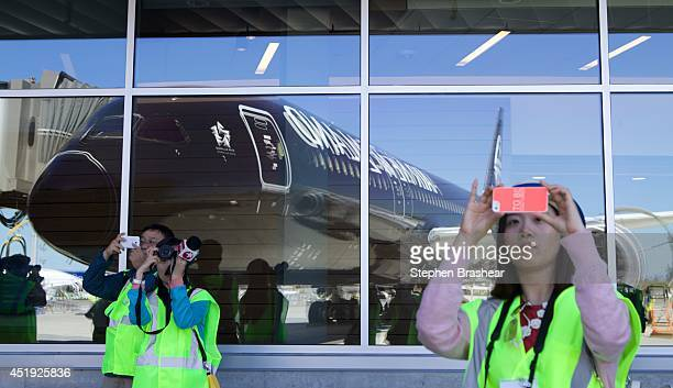 Media photograph an Air New Zealand Boeing 7879 Dreamliner reflected in the windows July 9 2014 in Everett Washington The 7879 Dreamliner was the...