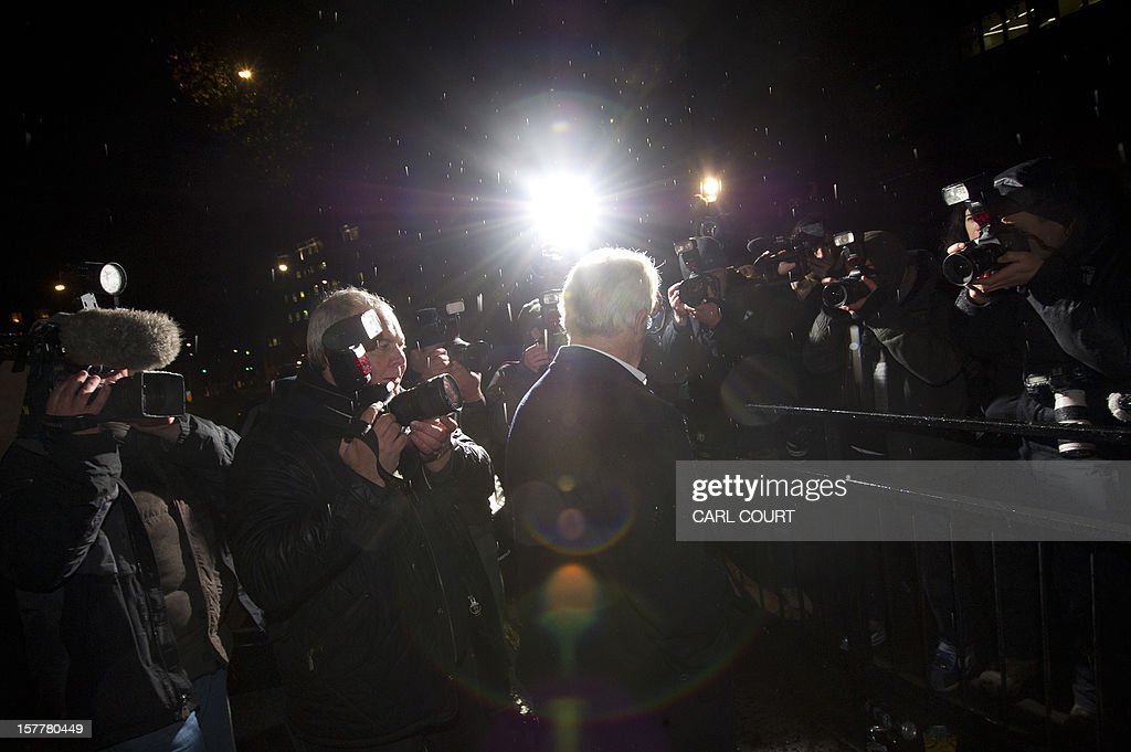 Media photographers surround British publicist Max Clifford as he leaves a police station in central London on December 6, 2012 after he was released on bail following his arrest on suspicion of alleged sexual offences. Clifford on December 6 said in a statement to journalists that allegations of sexual abuse against him were 'totally untrue' following his arrest by police earlier in the day. Clifford was arrested as part of a wider investigation into sex offences sparked by allegations that late BBC presenter Jimmy Savile was a serial paedophile. AFP PHOTO / CARL COURT