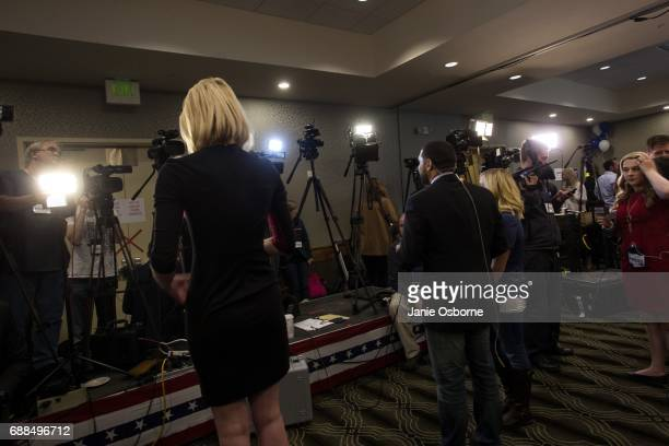 Media prepare to file reports at Republican Greg Gianforte's election party as guests wait to hear the outcome in Montana's special House election...
