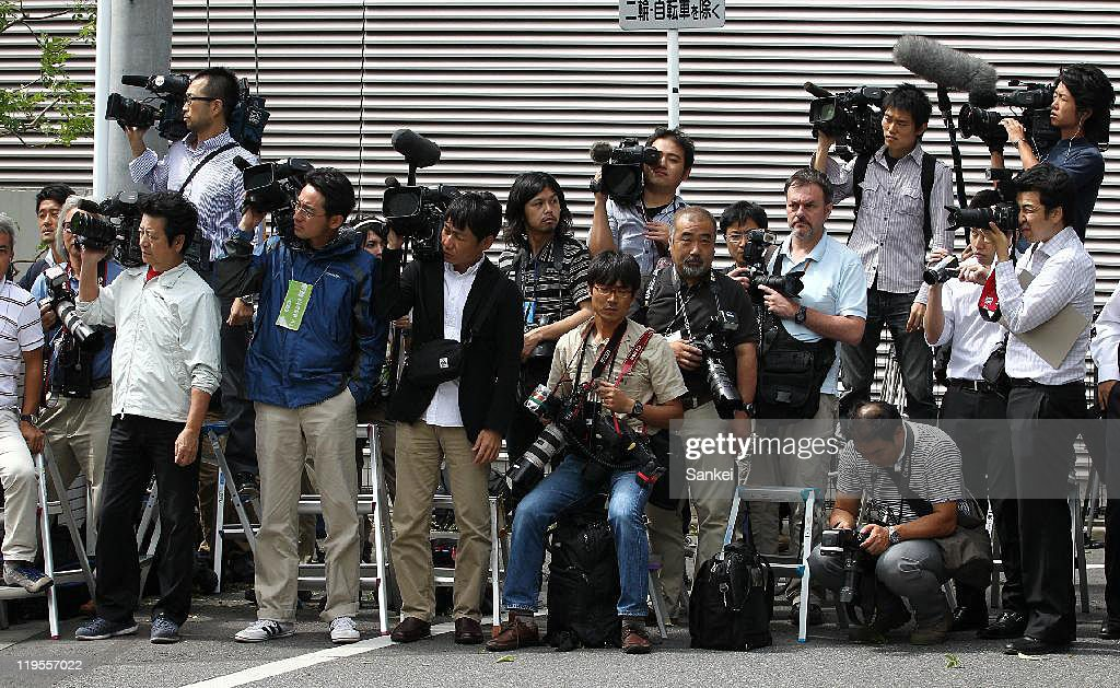 Media reporters and photographers wait for the family members of the murdered British teacher Linsay Ann Hawker at the Chiba District Court after the suspect Tatsuya Ichihashi was sentenced life in prison on July 21, 2011 in Chiba, Japan. Ichihashi was arrested in 2009 after the 2-and-half-year runout, having plastic sergery to escape.