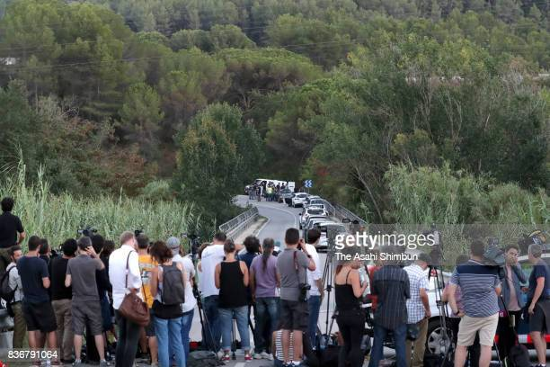 Media reporters gather at the site where Barcelona terror attack suspect Younes Abouyaaqoub was shot dead on August 21 2017 in Subirats Spain...