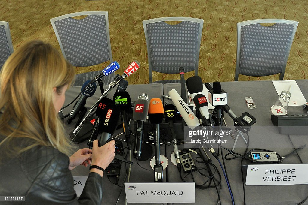 A media representative arranges a microphone prior to the UCI press conference on the UCI position concerning the USADA decision on the Armstrong case on October 22, 2012 in Geneva Switzerland. Cyclist Lance Armstrong has been banned for life and stripped of his Tour de France titles having been accused of leading 'the most sophisticated, professionalized and successful doping program that sport has ever seen' according to USADA officials.