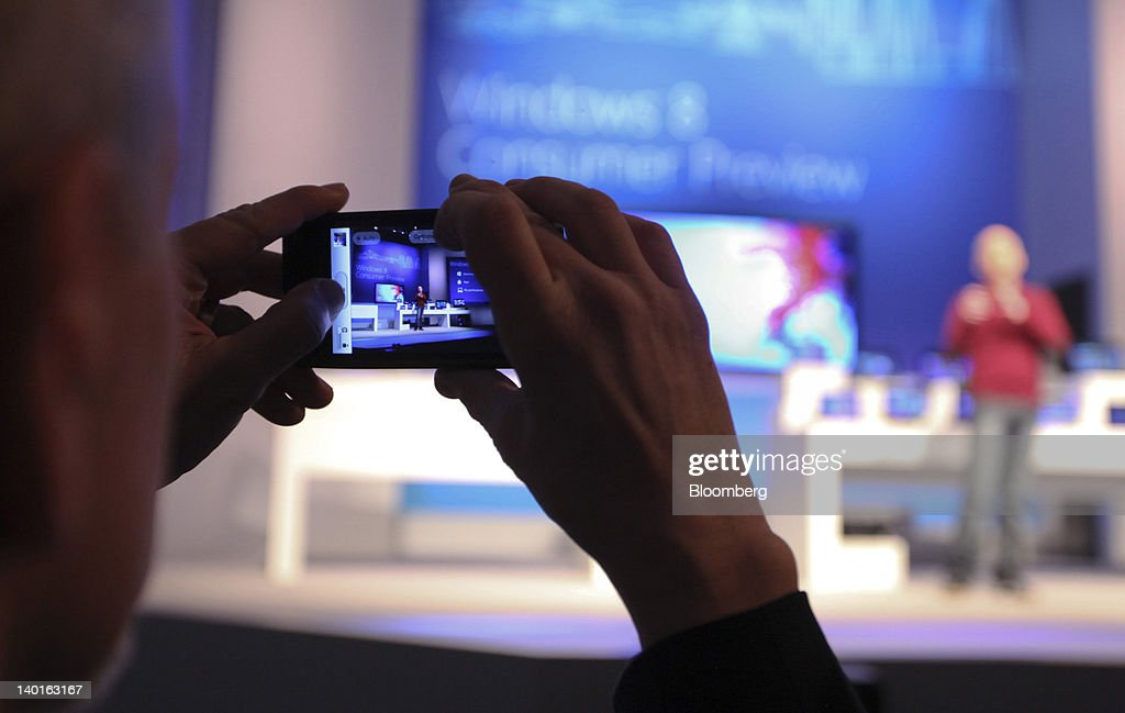 A media representative photographs Steven Sinofsky, president of Windows and Windows Live Engineering Group at Microsoft Corp., during a Windows 8 software consumer preview event at the Mobile World Congress in Barcelona, Spain, on Wednesday, Feb. 29, 2012. The Mobile World Congress, operated by the GSMA, expects 60,000 visitors and 1400 companies to attend the four-day technology industry event which runs Feb. 27 through March 1. Photographer: Chris Ratcliffe/Bloomberg via Getty Images