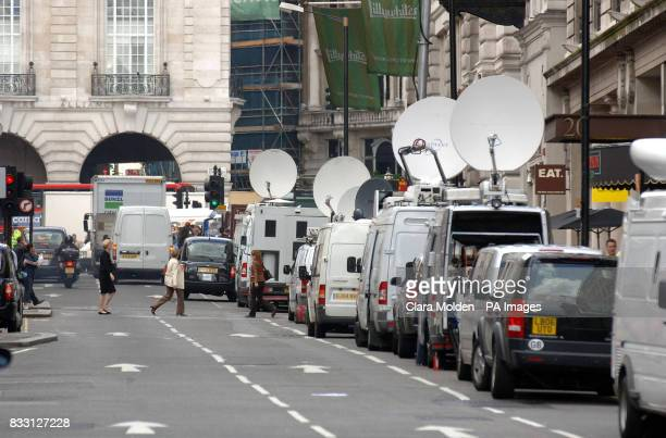 Media satellite trucks line Regent Street in central London as television crews cover the news that a car containing explosive devices was found on...
