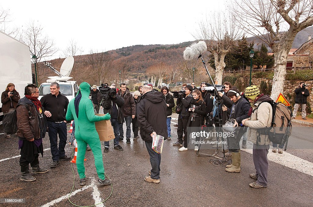 Media speak to people dressed as 'aliens' after the Mayan Prophecy failed to occur in Bugarach village on December 21, 2012 in Bugarach, France. The prophecy of an ancient Mayan calendar claimed that today would see the end of the world, and that Burgarach is the only place on Earth which will be saved from the apocalypse.