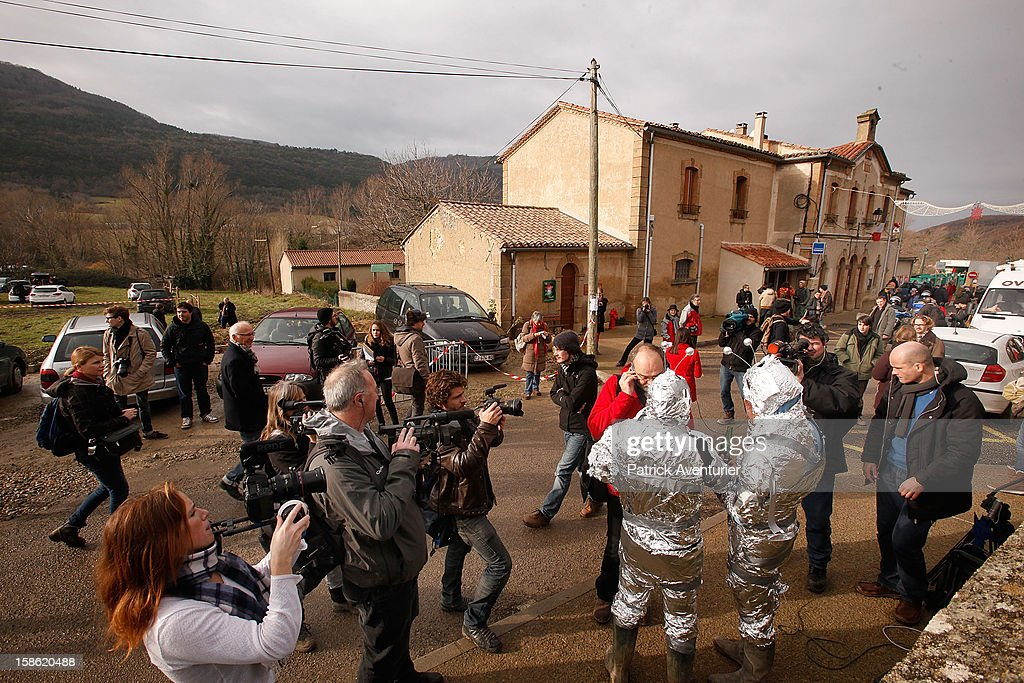 Media speak to people wrapped in silver foil in Bugarach village after the Mayan Prophecy failed to occur on December 21, 2012 in Bugarach, France. The prophecy of an ancient Mayan calendar claimed that today would see the end of the world, and that Burgarach is the only place on Earth which will be saved from the apocalypse.