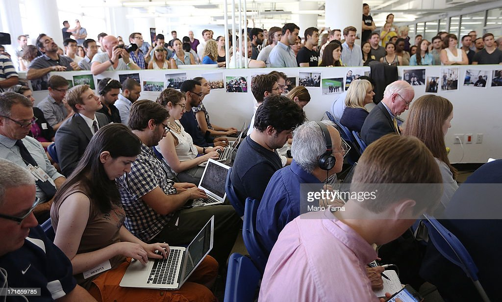 Media, Spotify employees and others gather as New York City Mayor Michael Bloomberg speaks at Spotify offices during a press conference on June 27, 2013 in New York City. Spotify will add 130 tech and engineering jobs in New York and expand to a new office in the Chelsea neighborhood of Manhattan.