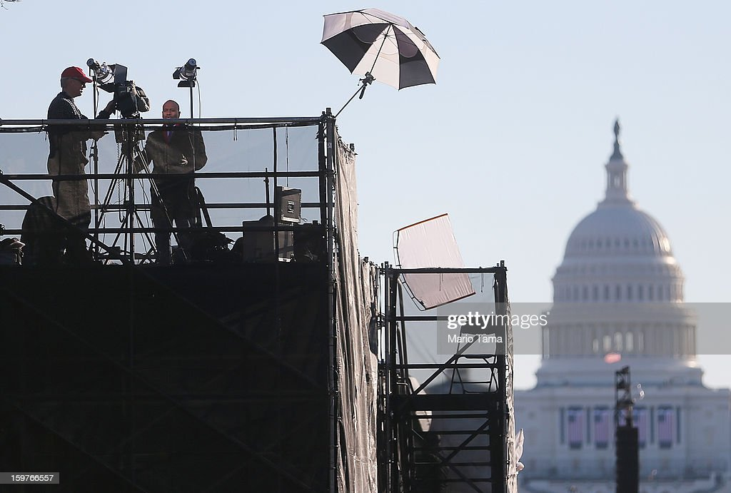 Media stand on a press riser in front of the U.S. Capitol building as Washington prepares for U.S. President Barack Obama's second inauguration on January 20, 2013 in Washington, DC. Both Obama and U.S. Vice President Joe Biden will be officially sworn in today with a public ceremony for the President taking place on January 21.