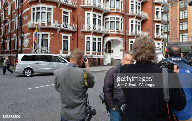 Media stand outside the Ecuadorian Embassy in London where WikiLeaks founder Julian Assange has been given asylum