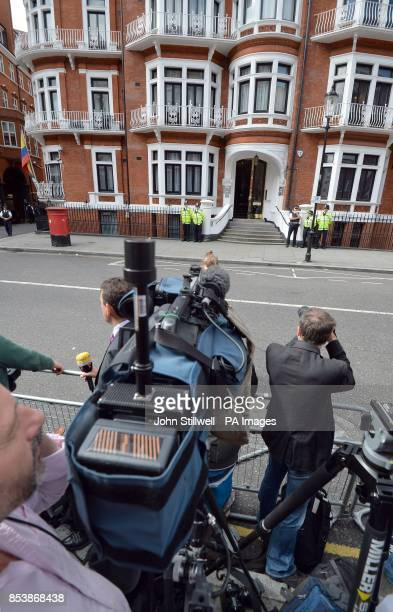 Media stand outside the Ecuadorian Embassy in London where WikiLeaks founder Julian Assange confirmed during a press conference that he will be...