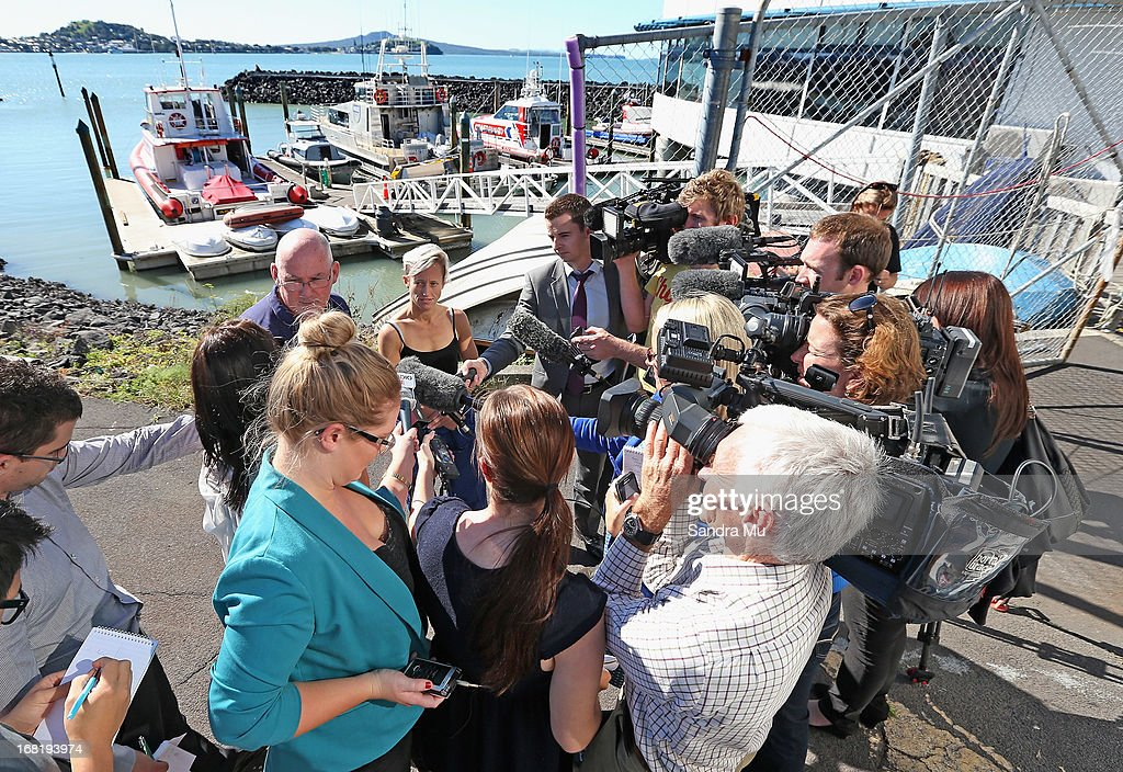 Media surround Pilot Peter Maloney and engineer Nina Heatley following their rescue from Waitemata Harbour after a helicopter crash on May 7, 2013 in Auckland, New Zealand. Both the pilot and a crew member - the only two on board walked away unscathed after their helicopter crashed into Waitemata Harbour in Auckland today. The two were resuced by the navy after the helicopter reportedly lost power and plummeted into the sea.