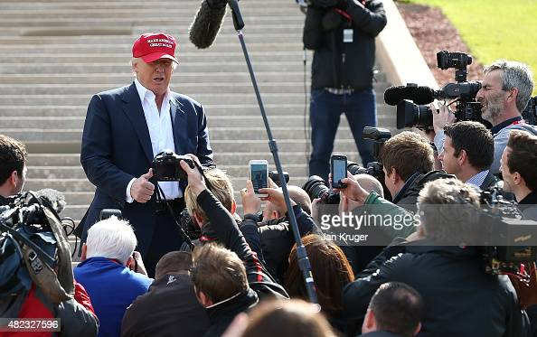 Media surround Republican Presidential Candidate Donald Trump as he visits his Scottish golf course Turnberry on July 30 2015 in Ayr Scotland Donald...