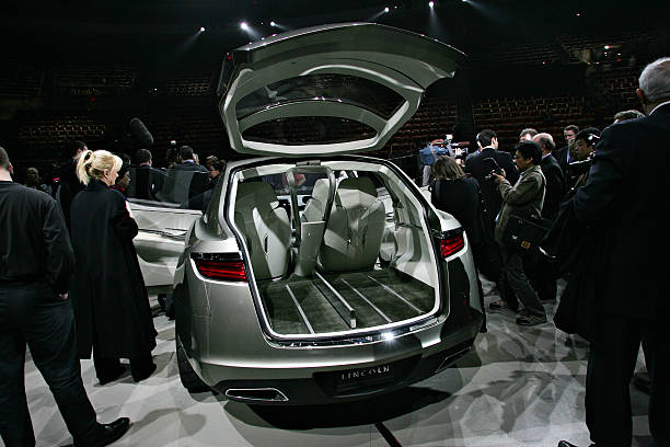 Media surround the Lincoln MKT concept vehicle following its ...