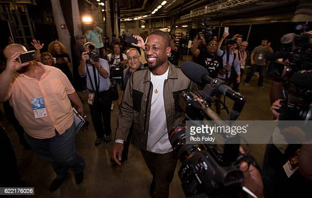 Media surrounds Dwyane Wade of the Chicago Bulls as he enters American Airlines Arena before the game against the Miami Heat on November 10 2016 in...